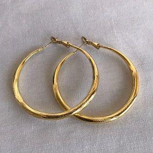 Gold tone pierced hoop earrings